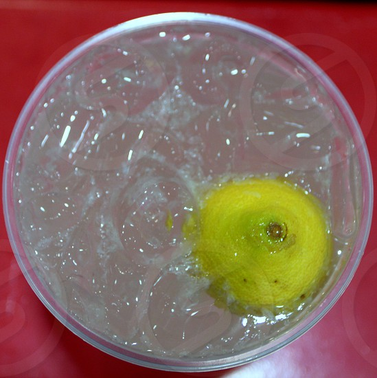 Hand squeezed lemonade from above with lemon half on red  state fair food photo