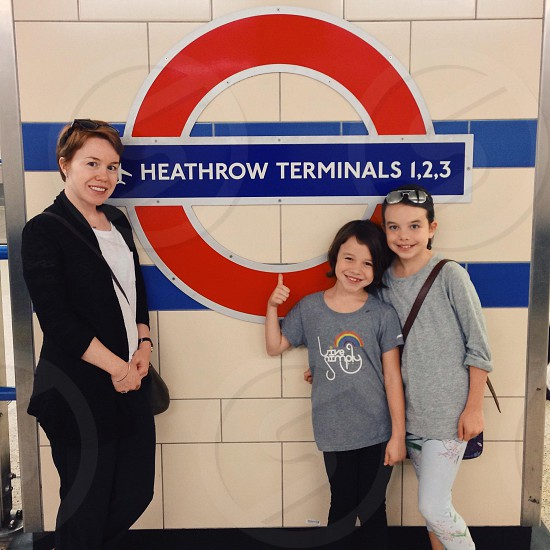 woman ans 2 girls at heathrow terminals 123 photo