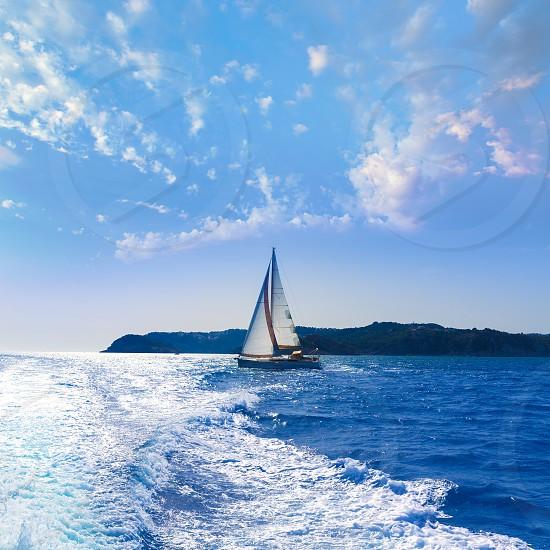 Javea sailboat sailing in San Martin cape Xabia at Mediterranean Alicante of Spain photo