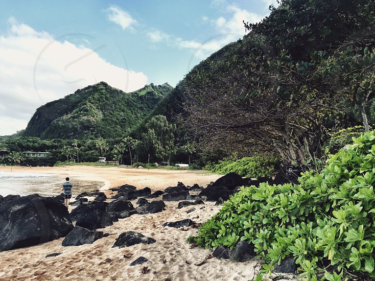 Beach; Kauai; water; ocean; sand; rocks; canyon; Waimea; rainbow; mist; coast; sunlight; cliffs; island; remote; vacation; explore; hiking; mountains photo
