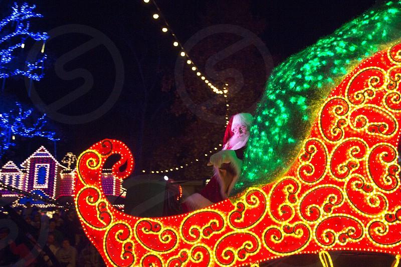 Santa in his illuminated sleigh during a parade Silver Dollar City Branson MO photo