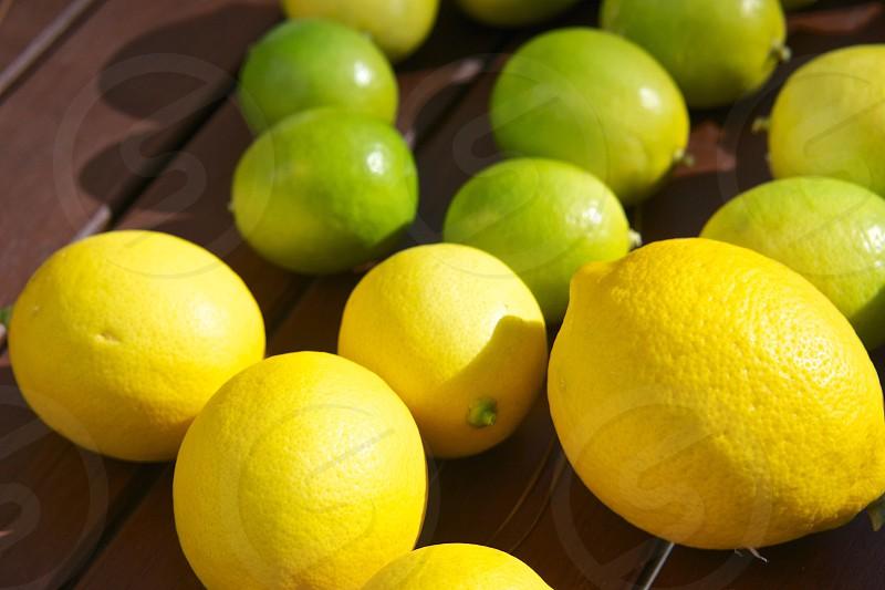 yellow lemons and green limes photo