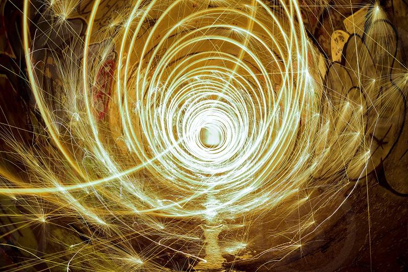 Long exposure tunnel steel wool sparks light painting urban graffiti dark grim photo