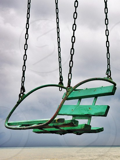 teal wooden swing photo