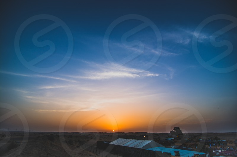 Sunset Over Ja-Al Market Place Arabian Desert Dubai United Arab Emirates  photo