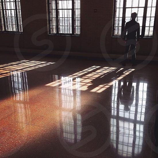 man standing on floor photo