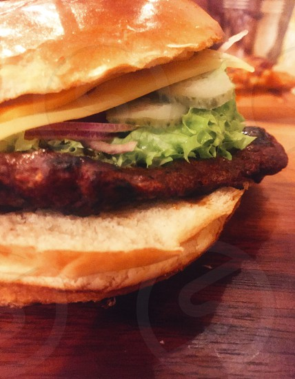 cheese burger with coleslaw and pickles photo