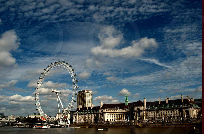 A beautiful day in London with the London Eye giving a panoramic view of the city photo