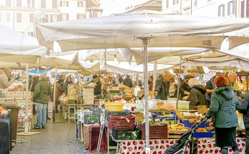 Roma Italy march 2017: people looking at fruits and vegetables for sale in the historic Campo de Fiori market in Rome Italy photo