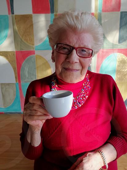 woman holding white ceramic mug during daytime photo