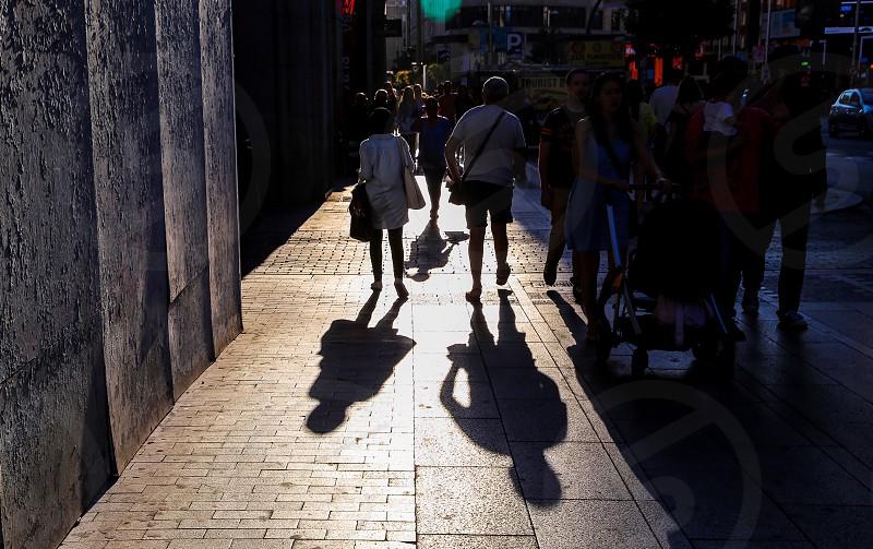 Street photo street people backlight  shadow-play shadows silhouettes streetlights sidewalk photo