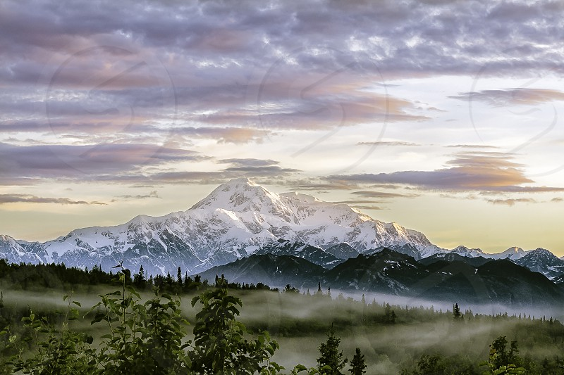 Denali mountain with mist at sunrise photo