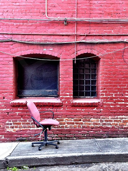 chairbrick wall painted brick rolling chair street scene pink  photo