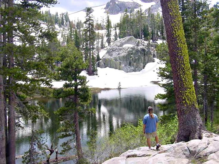 Hiker arrives at Shirley Lake in California. photo
