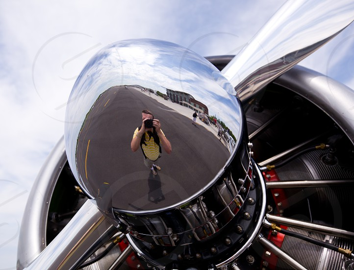 AT-6 Texan known as the Harvard training plane engine with reflection of photographer in propeller photo