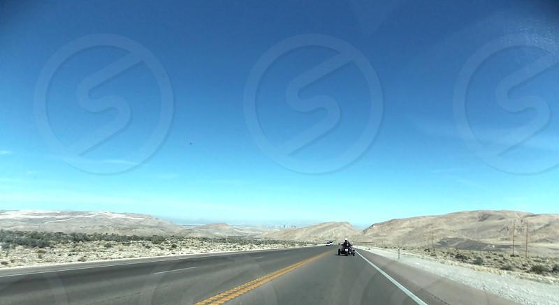 grey concrete road ahead photo