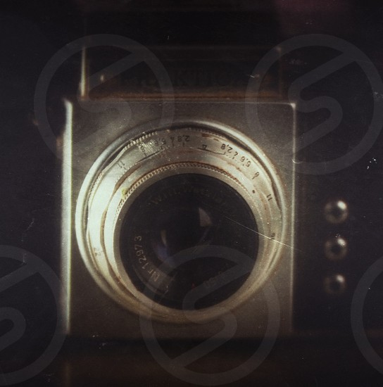 silver and black camera lens photo