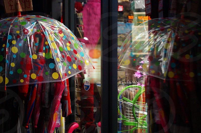 multicolored clear spotted plastic umbrella photo