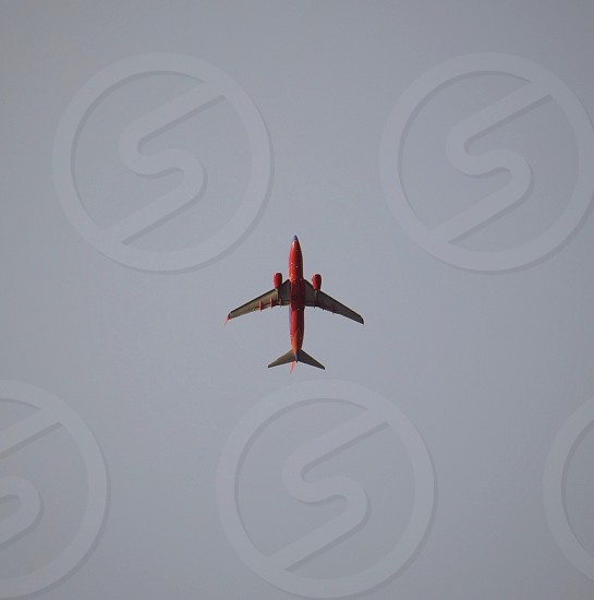 low angle photography of red airplane on sky photo