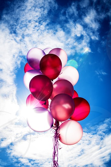Party balloons flying up in the air. photo