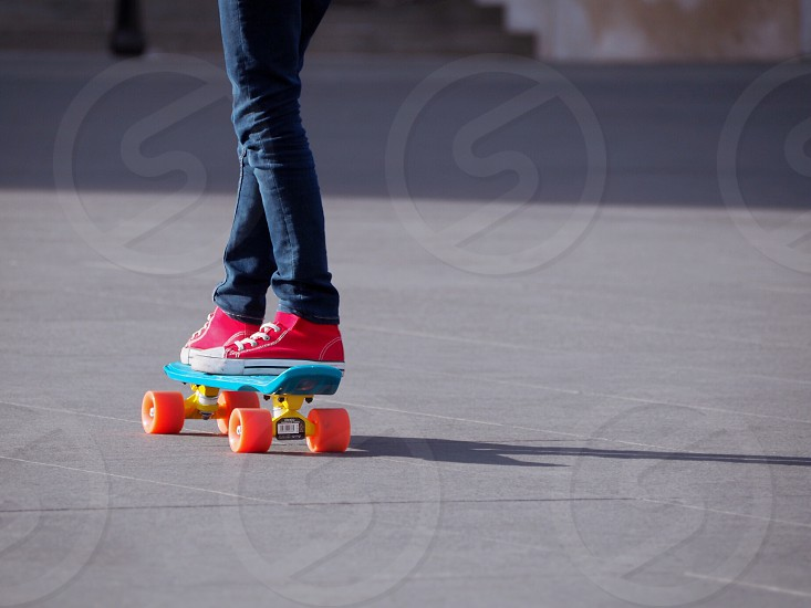 Teenager standing on a skateboard photo