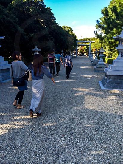 person walking towards shrine photo