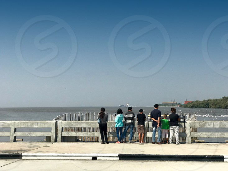 Tourists watching seagulls at Bang Pu Recreation Center a Thai Army's popular seaside resort in Samut Prakan Thailand photo