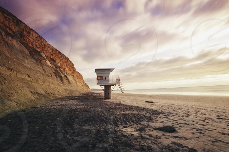 white and brown post on gray seashore photo
