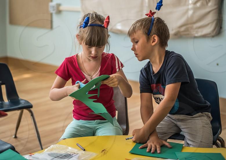 children at a summer camp making art photo