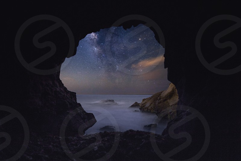 Milky Way reveals itself through a sea cave  photo