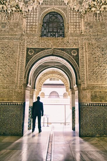 man standing wearing black suit photo