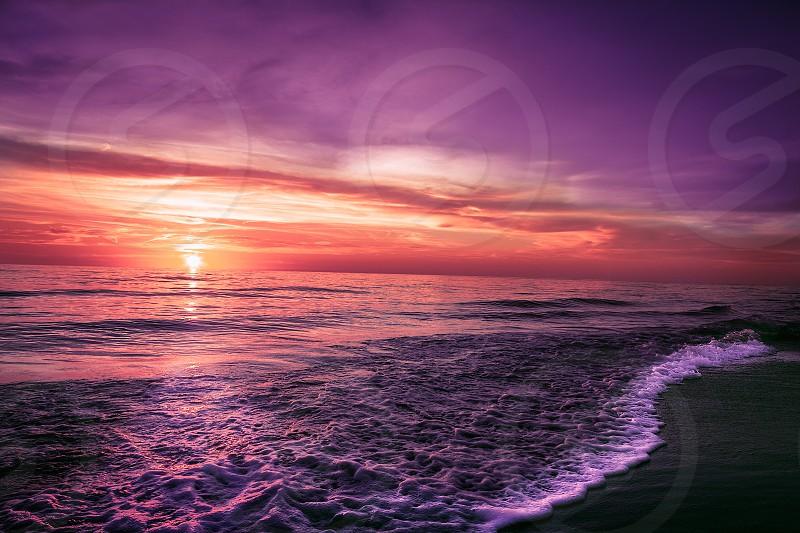 BeachsunsetFloridagolden hoursunoceanwatershorewaves photo