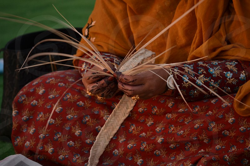 A traditional Emirati woman weaving photo