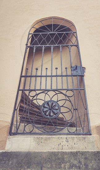 Old building front door with grating retro style photo