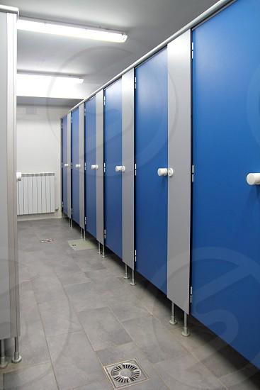 bathroom corridor doors blue pattern indoor toilette photo
