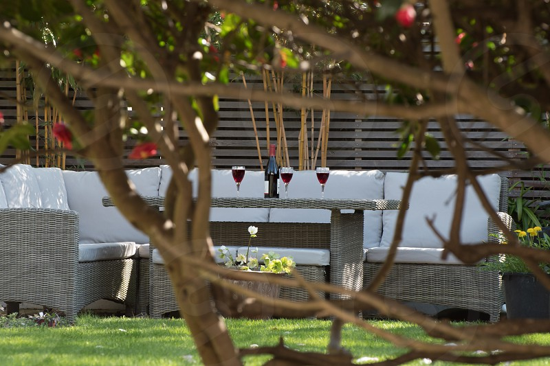 Beautiful day for a glass of wine in the shaded patio area photo