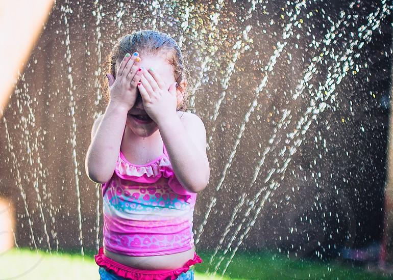 Sprinkler fun photo