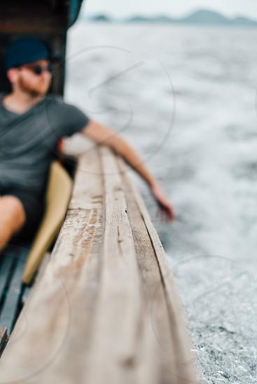 man on thai boat photo