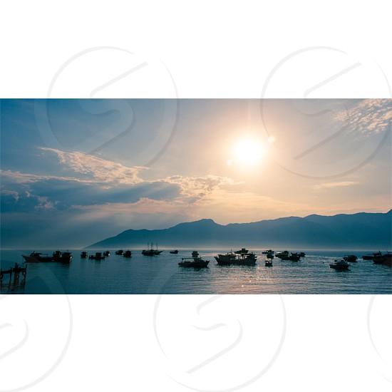 #landscape #boat #sun #cloud #mountain photo