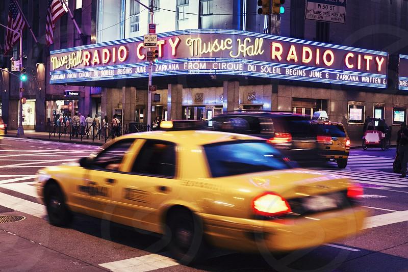 New York USA Radio City Music Hall yellow cab photo