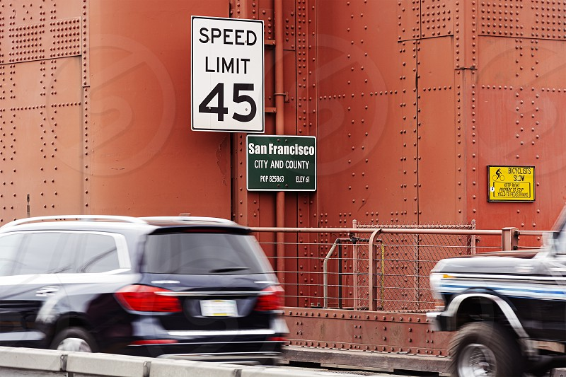 Traffic signs about speed limits and information panels on a tower of the Golden Gate Bridge in San Francisco. Entrance and information on the population of San Francisco photo