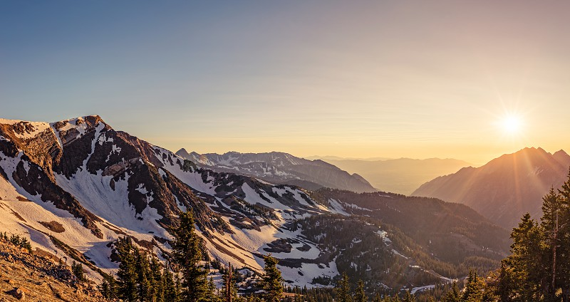 Panorama of a summer sunset in the Mountains at Snowbird Ski and Summer Resort Little Cottonwood Canyon Utah. photo