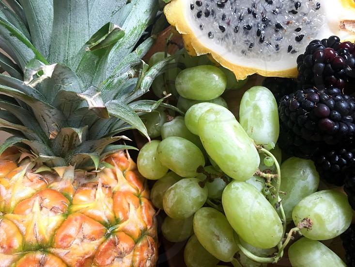 Pineapple green grape berries dragon fruit  photo