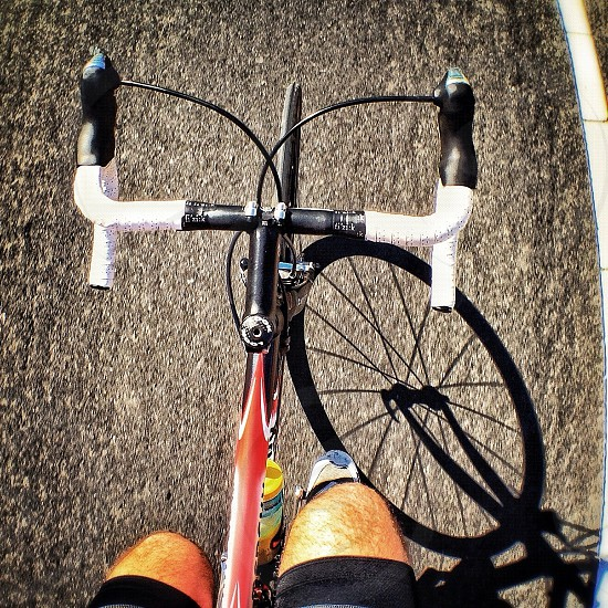 photography of red and black road bike photo