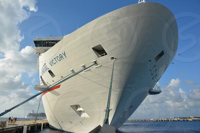 white ship on dock photo