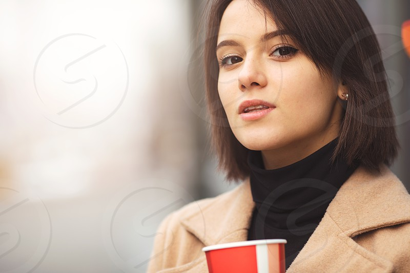 Woman Drink Her Hot Coffee While Walking On The Street. Portrait Of Stylish Smiling Woman In Winter Clothes Drinking Hot Coffee. Female Winter Style. - Image photo