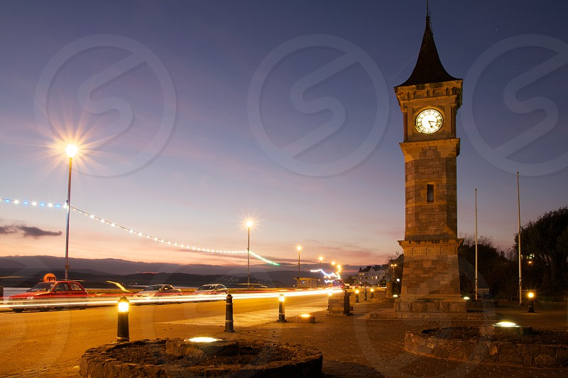 The town clock on the seafront at Exmouth Devon UK at sunset. photo
