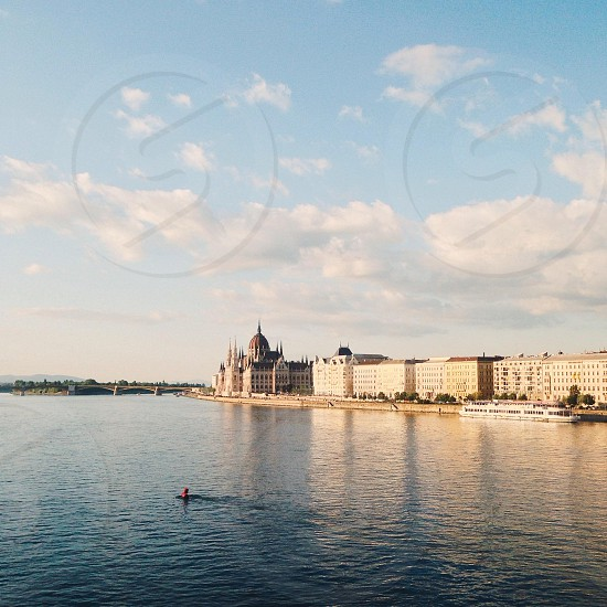 white concrete city buildings near body of water during daytime photo