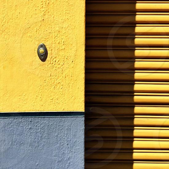 Wall doorbell yellow & black photo