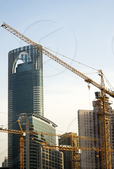 shanghai construction crane over modern building background photo